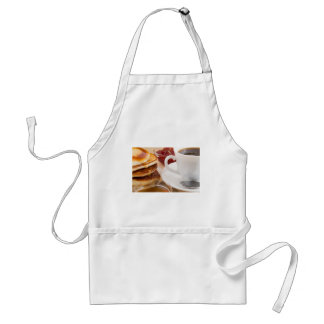 蜂蜜、イチゴジャムが付いているパンケーキ スタンダードエプロン