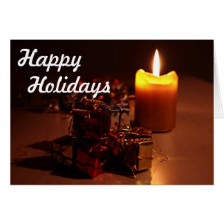 蝋燭およびギフトの幸せな休日 グリーティングカード