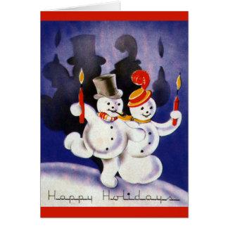 蝋燭が付いているヴィンテージのクリスマスの踊りの雪だるま カード