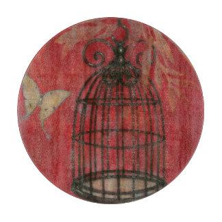 蝶が付いている装飾的な鳥かご カッティングボード