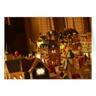 装飾的なクリスマスの村の町のクリスマスカード カード