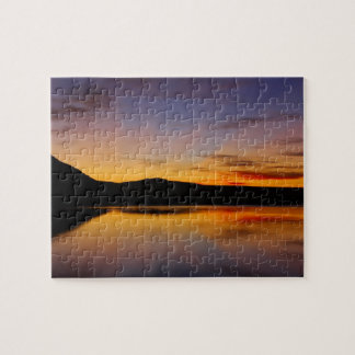 西の写真の困難なパズルの日没! ジグソーパズル