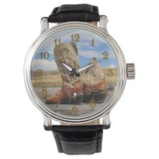 西部のカウボーイ・ブーツおよび拍車 腕時計