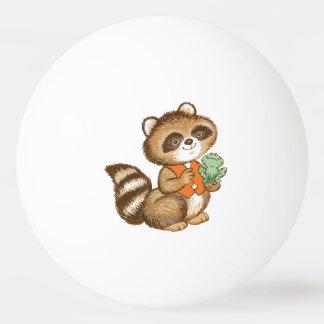親友のカエルが付いているオレンジベストのベビーのアライグマ 卓球ボール