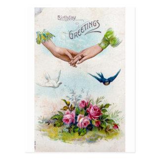 誕生日の挨拶の手および鳥 ポストカード
