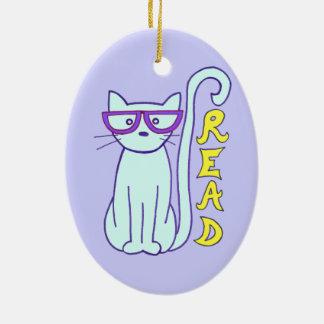 読書の印が付いている紫色ガラスを持つ光景猫 セラミックオーナメント
