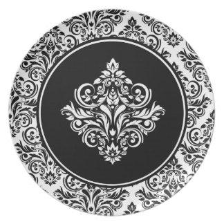 豪奢で黒いダマスク織の紋章が付いている王室のなダマスク織 プレート