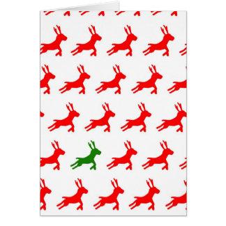赤いおよび緑のトナカイ カード