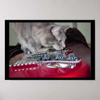 赤いエレキギターを持つ猫 ポスター