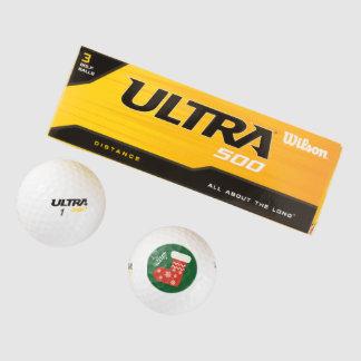 赤いクリスマスのストッキングのゴルフ・ボール ゴルフボール