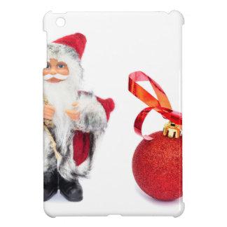 赤いクリスマスの球が付いているサンタクロースの置物 iPad MINI カバー
