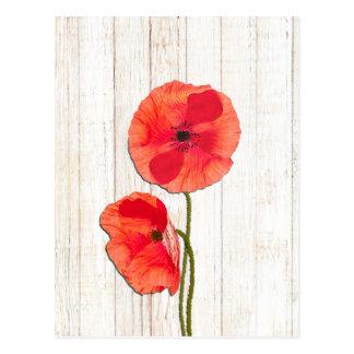 赤いケシの納屋の木製の背景のケシの納屋木 ポストカード