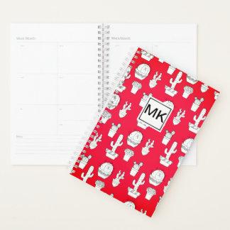 赤いサボテンのプリントのモノグラム プランナー手帳