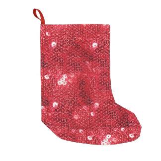 赤いスパンコール一見の背景 スモールクリスマスストッキング