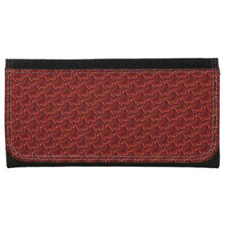 赤いドラゴンによってはかりで測られる大きい財布