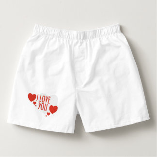 """赤いハートの形および文字が付いているズボン""""私は""""愛します。 ボクサー"""
