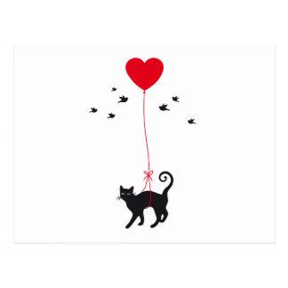 赤いハートの気球および鳥との猫の飛行 ポストカード