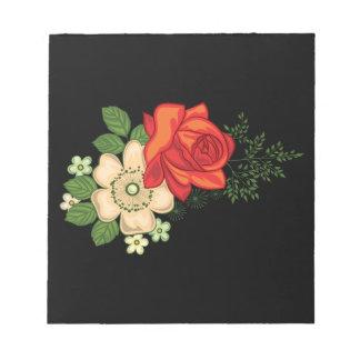 赤いバラおよびデイジーの黒い背景 ノートパッド