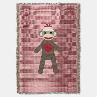 赤いパターンのソックスの猿によって編まれる毛布 スローブランケット
