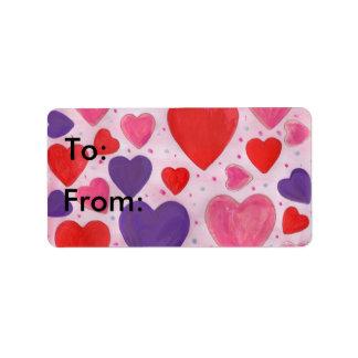 赤いピンクおよび紫色のバレンタインデーのハートのデザイン ラベル