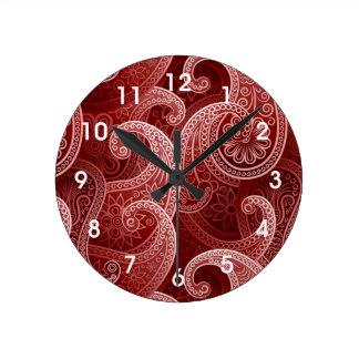 赤いペイズリーのエキゾチックなパターン ラウンド壁時計