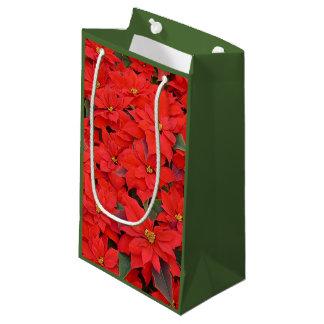 赤いポインセチアIのクリスマスの休日の花柄の写真 スモールペーパーバッグ