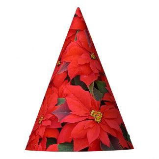 赤いポインセチアIのクリスマスの休日の花柄の写真 パーティーハット