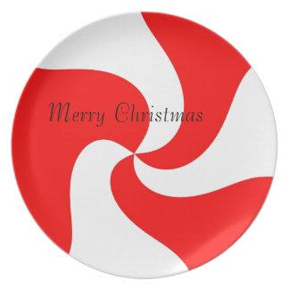 赤い及びホワイトクリスマスのクッキーのプレート