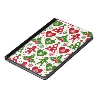 赤い及び緑のクリスマスツリーのジンジャーブレッドマンパターン iPad AIRケース