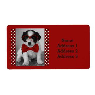 赤い弓およびガラスの住所シールを持つかわいい子犬 ラベル
