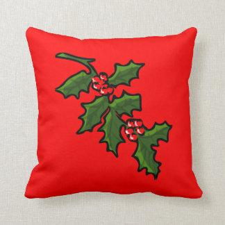 赤い果実が付いているクリスマスの休日のヒイラギの枝 クッション