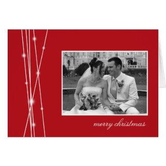 赤い棒及び雪のクリスマスの休日の写真の挨拶 カード