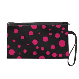 赤い水玉模様の化粧品の財布との黒 リストレット