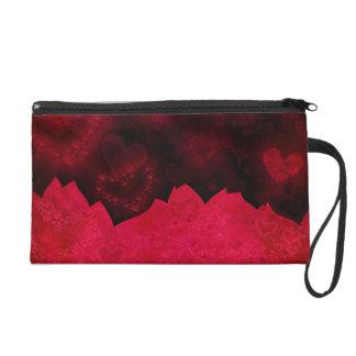 赤い白熱[赤熱]光を放つなハートおよび黒いリストレットのバッグ リストレット