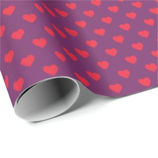赤い紫色の小さいハートのパターン(の模様が)あるな包装紙 ラッピングペーパー