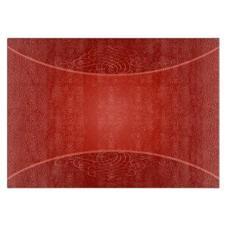 赤い背景のまな板 カッティングボード