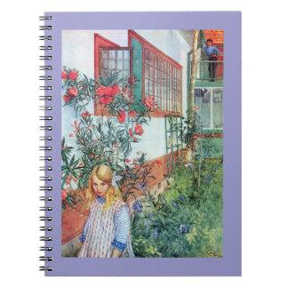 赤い花が付いている庭の女の子 ノートブック