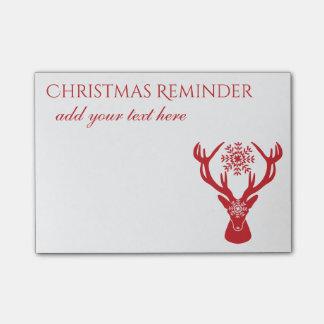 赤い雪片のシカのクリスマスのメモのノート ポストイット