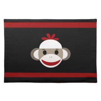 赤い黒のかわいい微笑のソックス猿の顔 ランチョンマット