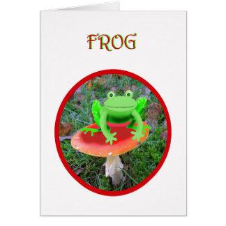 赤いtoadstoolに坐っている緑カエル カード