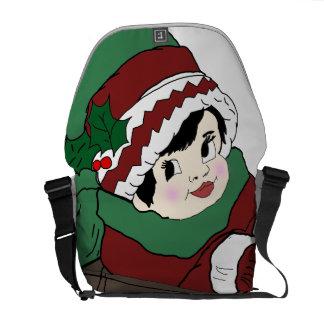 赤および緑のそりの小さな女の子 メッセンジャーバッグ