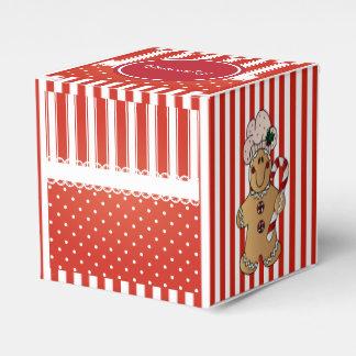 赤く及び白いキャンデーはジンジャーブレッドマンと縞で飾ります フェイバーボックス