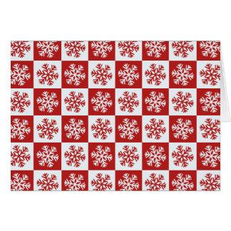 赤く白いチェッカーボードの雪片の挨拶状 カード