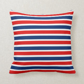 赤く白くおよび青のストライプのな枕 クッション