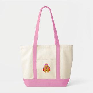 赤く、ピンクのジンジャーブレッドマンの英雄のキャラクター トートバッグ