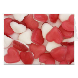 赤と白愛ハートの菓子の背景 グリーティングカード