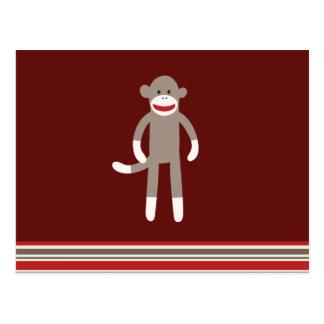 赤のかわいいソックス猿はとの縞で飾ります ポストカード