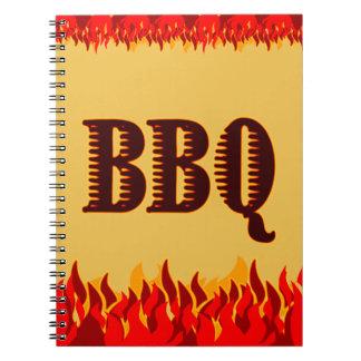 赤はBBQのレシピのノートを炎にあてます ノートブック