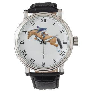 跳躍の馬に乗馬の腕時計を示して下さい 腕時計