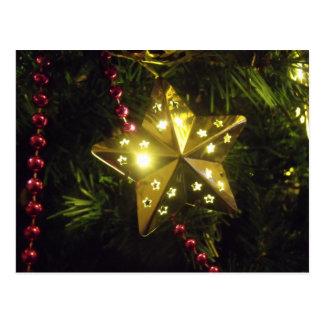 輝くな休日の星のクリスマスの照明 ポストカード